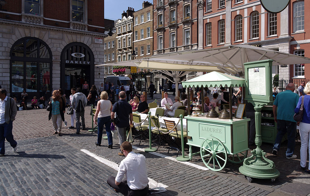 An outdoor café in London's Covent Garden Market. Taken by Wikimedia Commons user mattbuck.